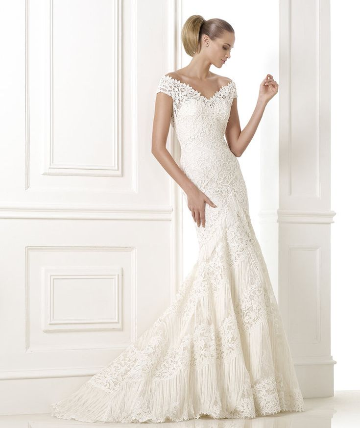 New  u Pronovias KAIRA Lace and guipure wedding dress with fringe appliqu s on the skirt Lace bodice with wrap around V neck and sheer back