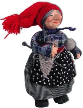 """Knitting Grandma Nisse SKU: 39473 U$49 Grandma Nisse never goes far without her knitting!  She is crafted in Norway with beautifully detailed  clothing, needles and yarn,  and a very personable molded face. 7"""""""