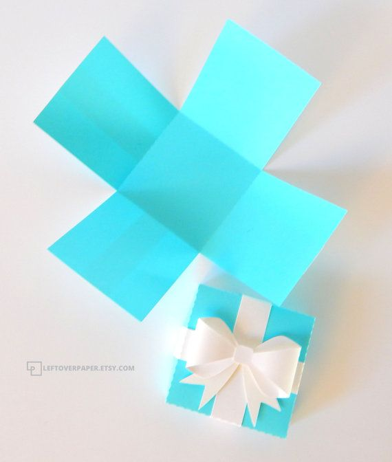 This cute favor box is made to look similar to a tiffany box. All four walls of…
