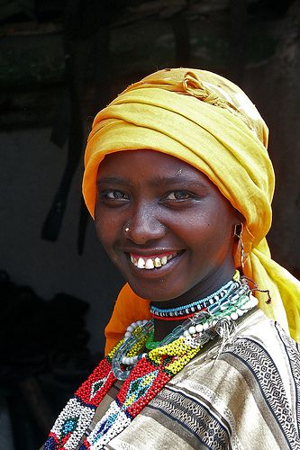 Veiled woman smiling, Harar, Ethiopia, photo by Eric Lafforgue