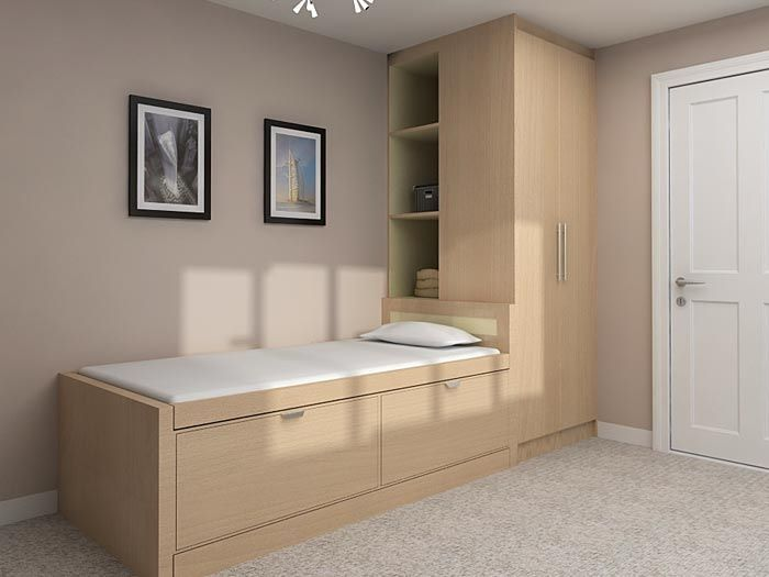 Bed, wardrobe and shelves built over stair box
