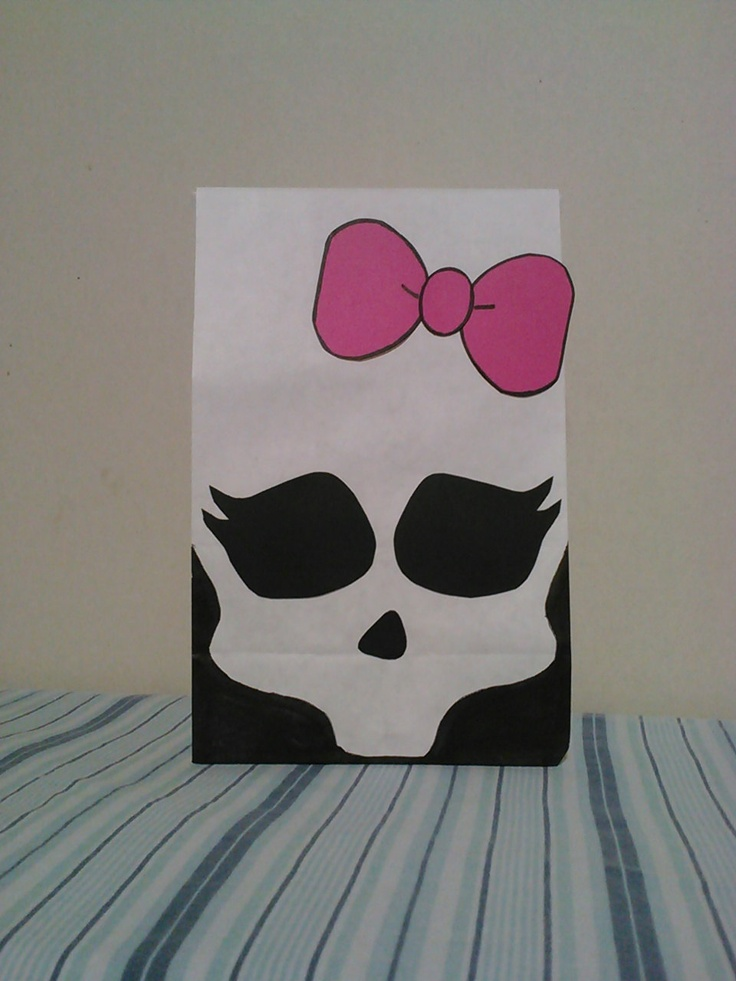 Monster High inspired birthday party/treat bags. Would make a simple diy with a white paper bag and a black marker