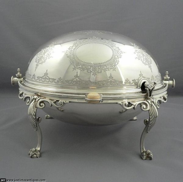 Victorian Silver Breakfast Dish    A beautiful Victorian sterling silver breakfast dish hallmarked London 1874 by Walter & Charles Scissons. Oval body on leaf capped ball and claw legs with revolving lid engraved with scrolls and flowers.