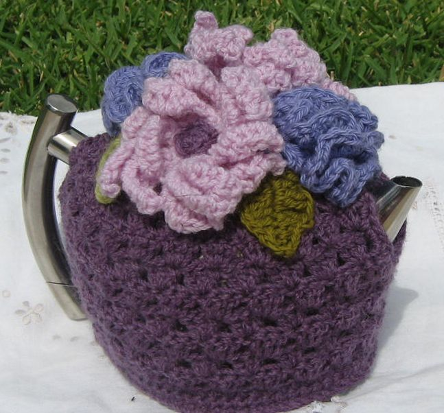 Crochet tea cosy toped with flowers and leaves made from Australia wool.