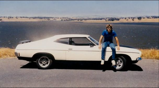 Eric Bana (in his youth) on his original XB Ford Falcon Hardtop.