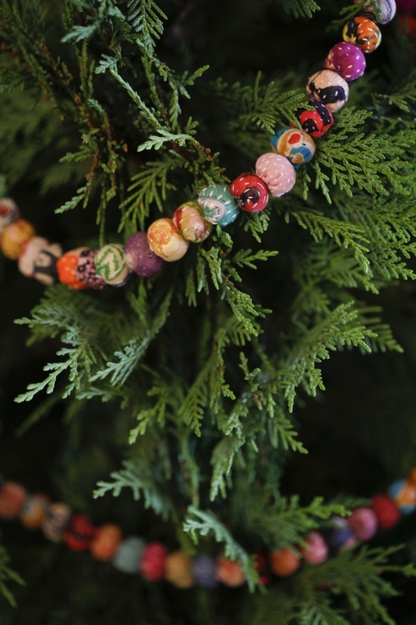 fabric with filling, small ornaments, jingle bells, beads, candy, berries.. anything goes for a garland.