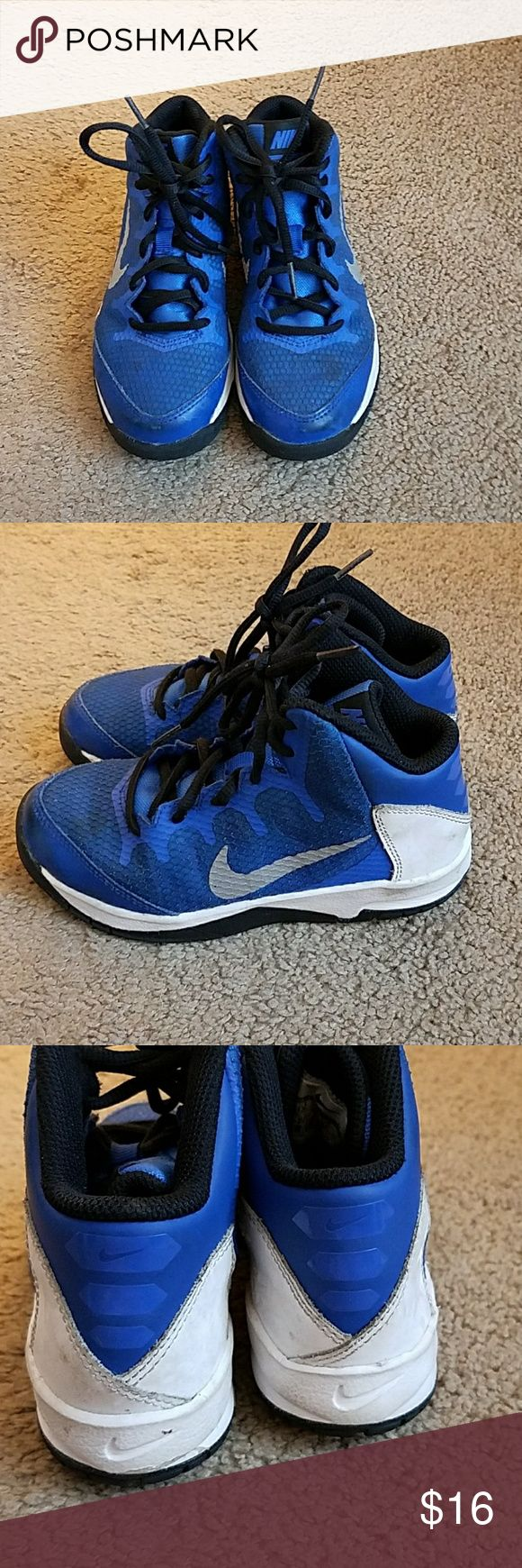 Nike Boys Basketball Shoes Size 13 Nike Boys Basketball Shoes Size 13 Blue, Black, and White with Silver Swoosh Great condition overall but the pictures are showing they are dirty, have not tried to clean. No holes, snags, or tears. Nike Shoes Sneakers