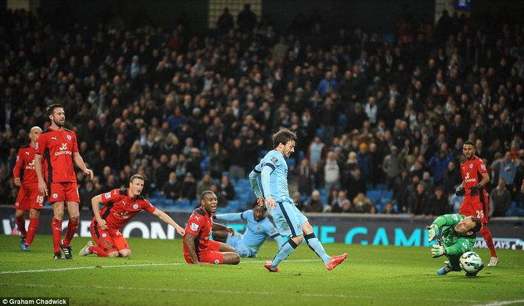 David Silva shoots the ball past Leicester goalkeeper Mark Schwarzer to give Manchester City the lead just before half-time