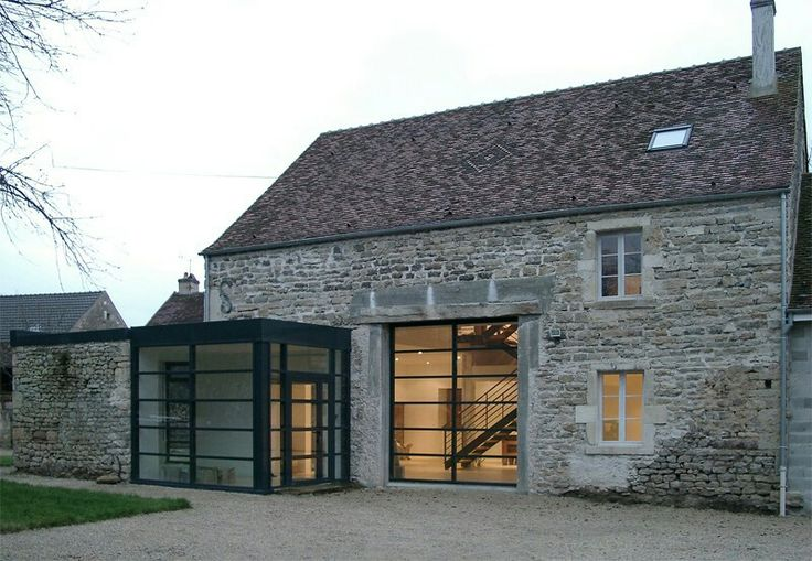 A classic conversion from old stone building to modern home. Very subtle and respectful. Love those old stone buildings...