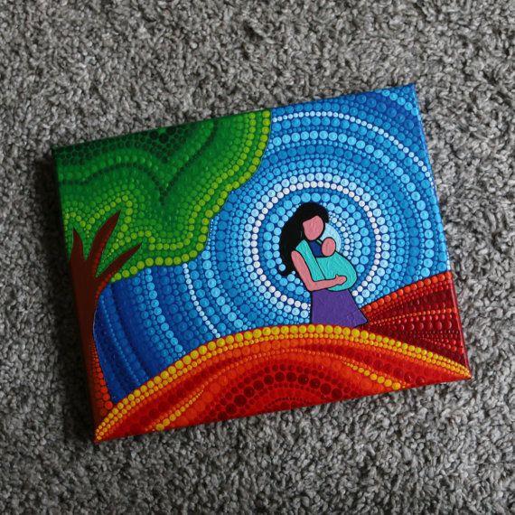 Een doek op een houten raam van 1,8 cm dik beschilderd met acrylverf met mandala. Het formaat van de kunst is 24 x 30 cm. Op dit originele schilderij staat een moeder met een kindje of baby in een draagdoek. Het idee met de stippen en mandala is geïnspireerd op Elspeth McLean.  Ik verstuur het schilderij binnen 1-3 dagen met track & trace code. Indien je de kunst bij mij in Apeldoorn (Nederland) wilt afhalen, voer dan bij de kortingscode afhalen in.  Uiteraard geeft elke computer de kleu...