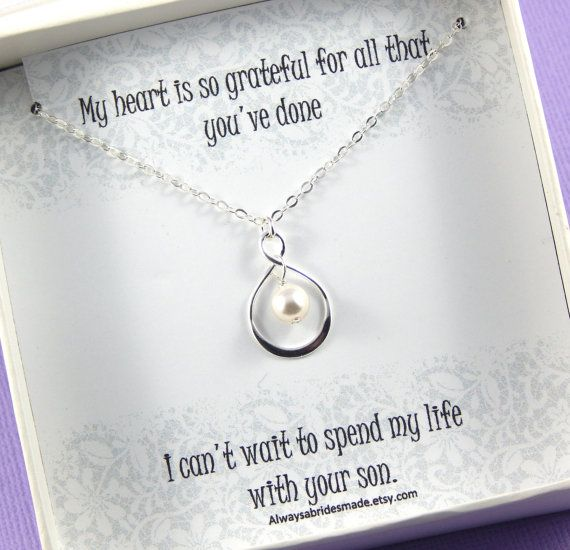 Mother Of The Groom Gift - Gift Boxed Jewelry Thank You Gift An ideal way to thank the lady responsible for your adoring husband. A sterling silver infinity symbol holds a single white swarovski pearl, suspended from a sterling silver chain. The necklace comes beautifully gift boxed wrapped in a satin ribbon. Choose your necklace length from the drop down menu provided, if no note is left you will receive the 42cm ( 16) necklace pictured. Also available in gold filled. https://www.etsy.c...