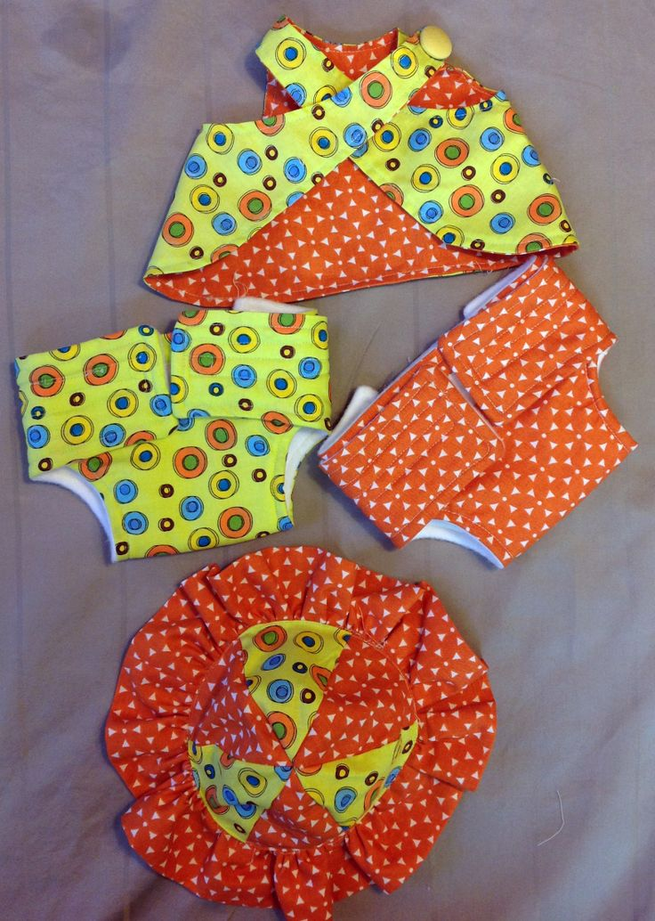 Reversible sundress set  with velcro diapers and sunhat.