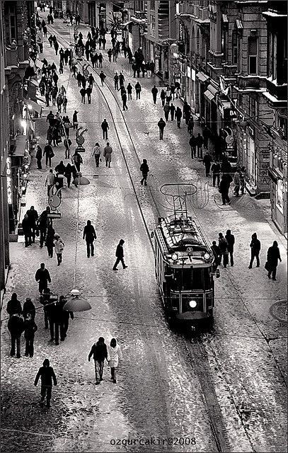 """Istiklal Street, Beyoglu, ancient Pera district . Beyoglu is derived from both """"Bey-Oglu"""", Son of Bey, and """"Bailo"""", the Venetian Ambassador who lived in a grand Palace in Pera . Also Pera means """"across"""" in Greek, as in Across the Golden Horn from Byzantium, and yes, the Byzantines were Greeks. And lo and behold, the tramways still run, and yes it does snow on occasion in Isty. When it does, it is a hell of a fun slip-sliding town."""