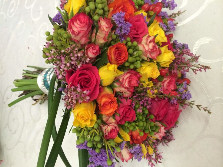 Bridal bouquet with roses, limonium, heather, kolkol and petisporum