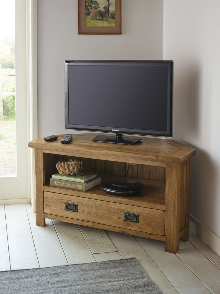Handcrafted from A-grade solid oak, the Original Rustic Solid Oak Corner TV Cabinet will effortlessly accommodate your television set and all associated hardware and media. Forming part of our popular Original Rustic Solid Oak Range, the cabinet is defined by a beautifully aged appearance with softly rounded corners, chamfered edges and antiqued handles.