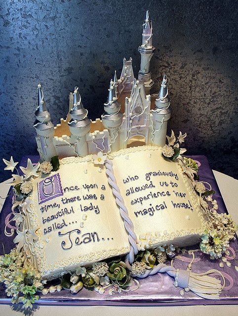 "I have an idea..   Alex & I met while doing internships at Disney..  So, what if we had a nontraditional wedding cake. It would be a stack of books, with an open book on top. It would look similar to this, but on the right side it would say ""...and they lived happily-ever-after."" with a little scroll thing at the bottom! Then on the left side, there could be a cartoon picture of us looking all happy. Cheesy? Yes.. but it would totally fit with my ""happily-ever-after"" theme!!  @Roxanne…"