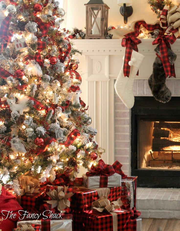 The Fancy Shack: Christmas Home Tour 2015-  flocked Christmas tree with plaid buffalo check ribbon.