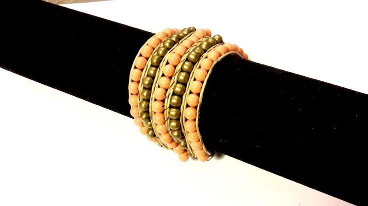 Bracelet manchette perles orange corail et bronze : Bracelet par indyacreations