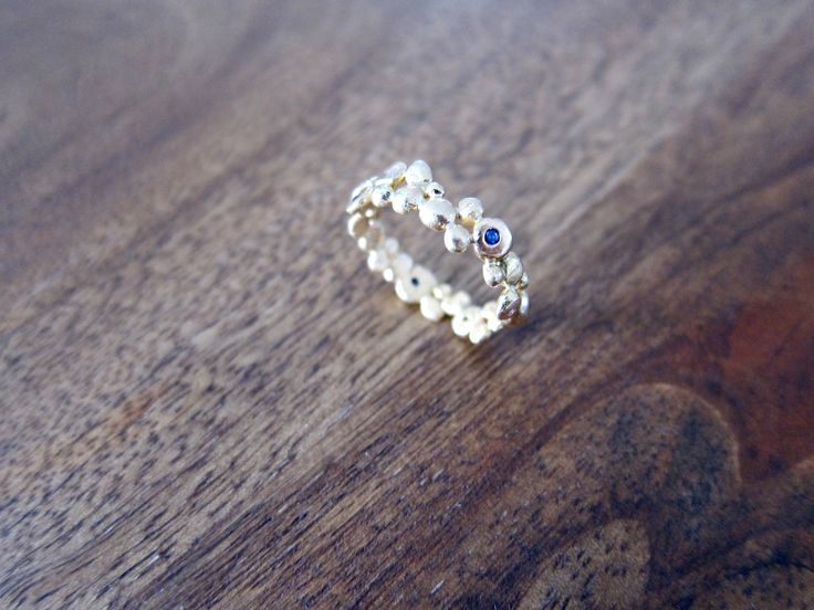 Rustic 22ct yellow gold granule ring set with Australian sapphires and white diamonds, http://fairinachengjewellery.com #contemporaryjewellery #gemstones #uniquering #contemporaryjewelry #uniqueweddingring #engagementring #weddingring #customring