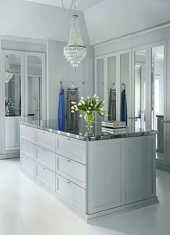 Get The Hollywood Look - Traditional Home® ~ A dressing room painted in soft gray features mirrored closet doors and a stainless-topped island for extra glam.  #design #interior #interior_design