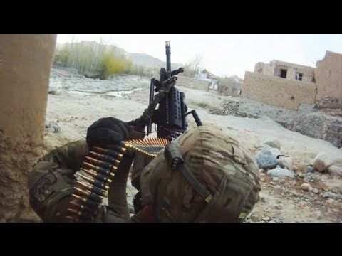 The MK-48 machine gun and M203 grenade launcher are used to suppress Taliban firing positions during a firefight. This footage is part of an ongoing documentary of the war in Afghanistan through raw combat footage.