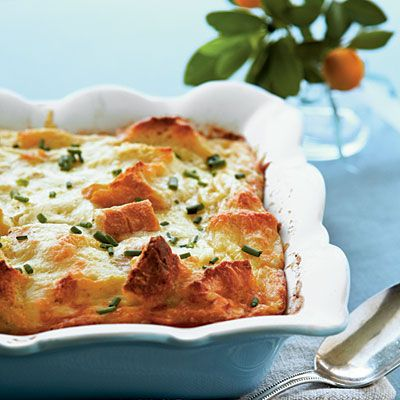 Creamy Egg Strata | Made with Swiss and Parmesan cheese atop a base of french bread cubes, this creamy egg dish is worth waking for.