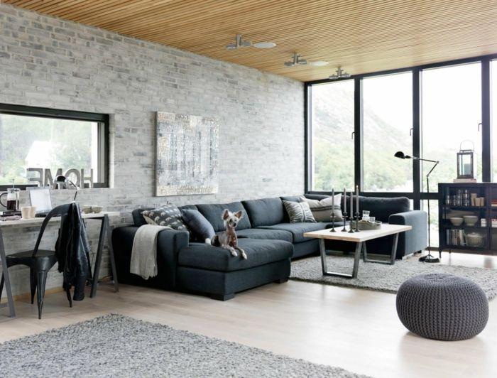sofa grau wohnzimmer industriell offener wohnplan steinwand - Steinwand Grau