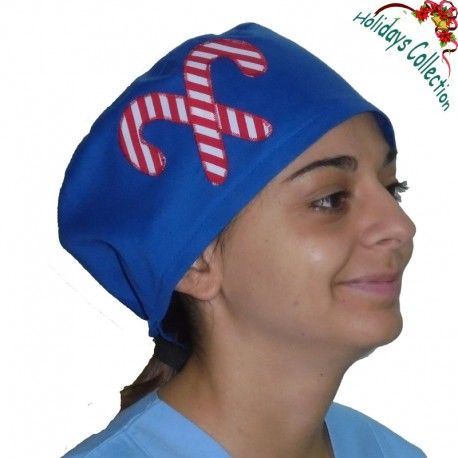 Handmade applique scrub. This lovely Christmas scrub hat can be used for every medical or hospital use. Two delicious candy canes are placed on the side!