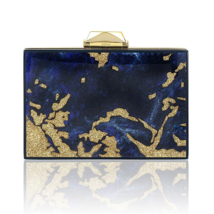 Inspired by the Hollywood Regency interiors of Tony Duquette, the Taylor Cloisonne Lapis captures the spirit of the designer's wonderfully eccentric life. The clutch is created by hand using the ancient cloisonne technique of fine bronze wire and enamelling originally displayed in Byzantine jewelery and Chinese porcelain. The panels are set in a gold-plated brass frame, with signature KOTUR brocade lining and faceted closure with a 30 cm drop in chain. It fits your evening essentials, and...