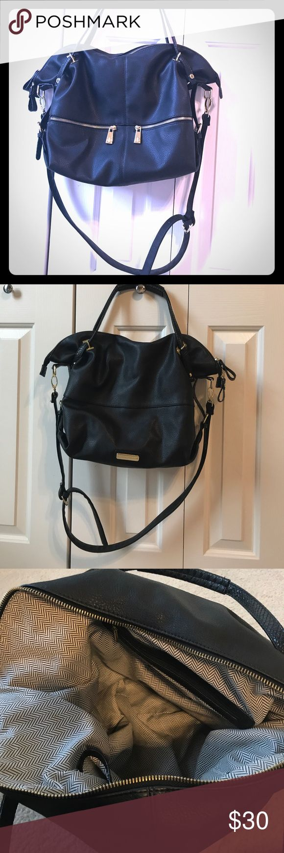 "Steve Madden large black leather satchel purse Large black leather purse with gold hardware. Has 2 shoulder/arm straps and removable/adjustable crossbody strap. 2 zip exterior pockets. 2 interior slip pockets and 1 interior zip pocket. Only used a few times, great condition. L 15"" W 4"" H 13"". Crossbody strap 36.5""- 42"". Handles 17.5"" long Steve Madden Bags Satchels"