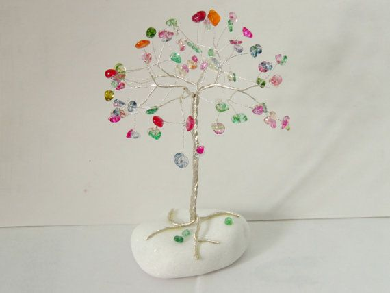 Check out this item in my Etsy shop https://www.etsy.com/listing/248428072/multicolor-quartz-gemstone-wire-tree