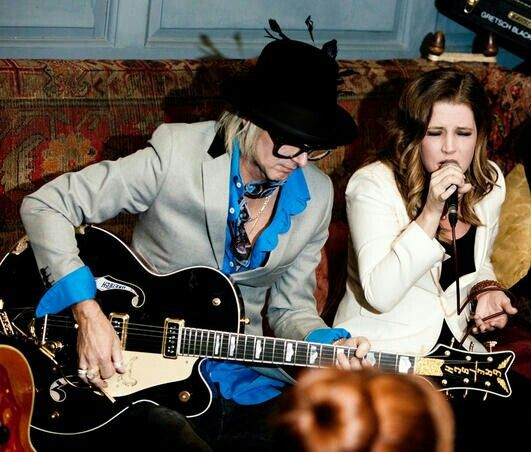 {*Lisa Marie Presley with her Hubby Michael Lockwood in 2012*}