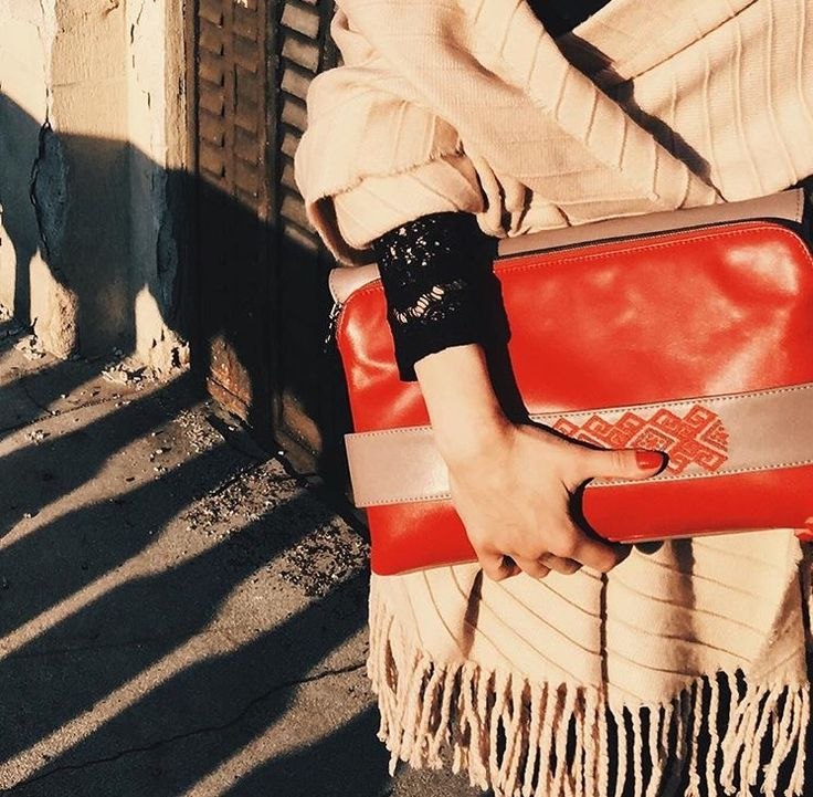 The #joyofewearingiutta on a winter afternoon. Red leather bag with handmade embroidery #leatherbags #iutta #redbag