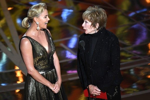 Charlize Theron Photos Photos - South African-US actress Charlize Theron (L) and US actress Shirley MacLaine stand on stage as they present the Best Foreign Language Film award at the 89th Oscars on February 26, 2017 in Hollywood, California. / AFP / Mark RALSTON - 89th Annual Academy Awards - Show