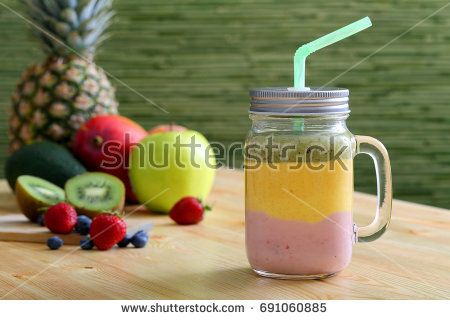 colorful smoothie with fruit in mason jar