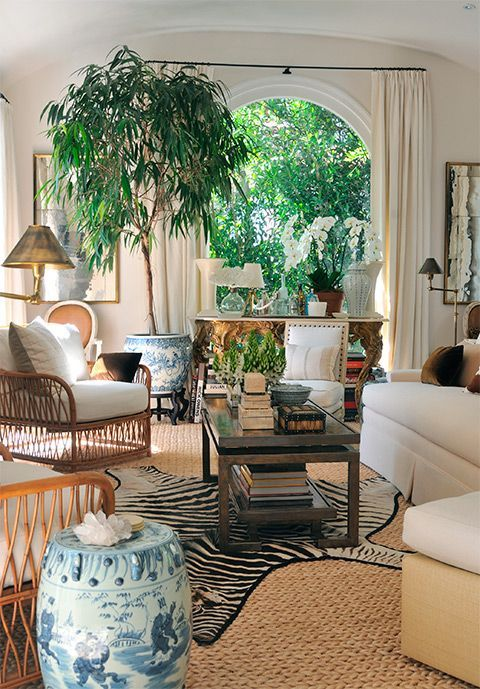 Beautiful white living room with zebra rug.