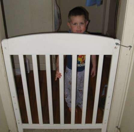 dog gate from old crib. -  I'm looking at that hook and thinking... WHY... Why didn't I think of that!  All those stupid expandadble gates... that stupid people try to climb over!  This would be soooo easy!