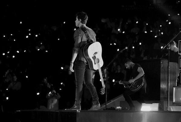 Shawn Mendes Photos Photos - Image has been converted to black and white.)  Shawn Mendes performs onstage during the 2017 MTV Video Music Awards at The Forum on August 27, 2017 in Inglewood, California. - 2017 MTV Video Music Awards - Fixed Show