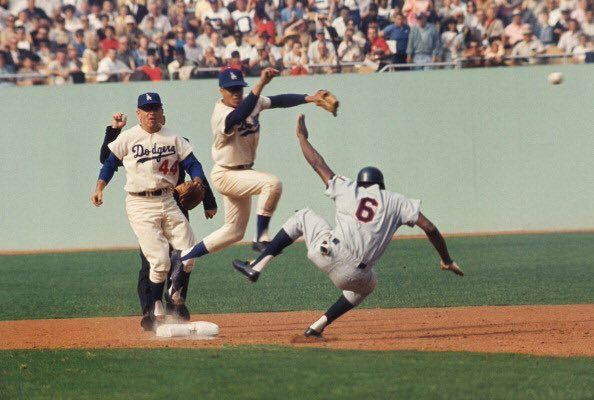 1965 World Series at Dodger Stadium: Tony Oliva with a hard slide into Maury Wills.