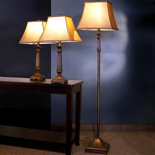 This beautiful traditional lamp set includes a floor lamp and two table lamps to transform and illuminate your home. These lovely lamps feature bronze finished metal bases for a classic look, with warm gold flared fabric shades for the perfect finishing touch. Add these sophisticated lamps to your home for a quick style update.