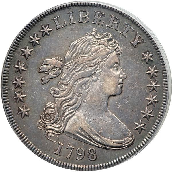 1798 Draped Bust Dollar. Large eagle, close date. PCGS AU50 Was previously in an NGC AU55 holder. A lovely example exhibiting golden shades and a touch of blue-green hues about the border. What an astonishing, full-featured example this is, of the best possible quality for its high-end AU50 grade, a coin whose lovely medium gray surfaces play host to robust detail, smooth, mar-free beauty, and exceptional strike on the stars, rims, and all main devices. Knob 9 in date. This obverse is paired…