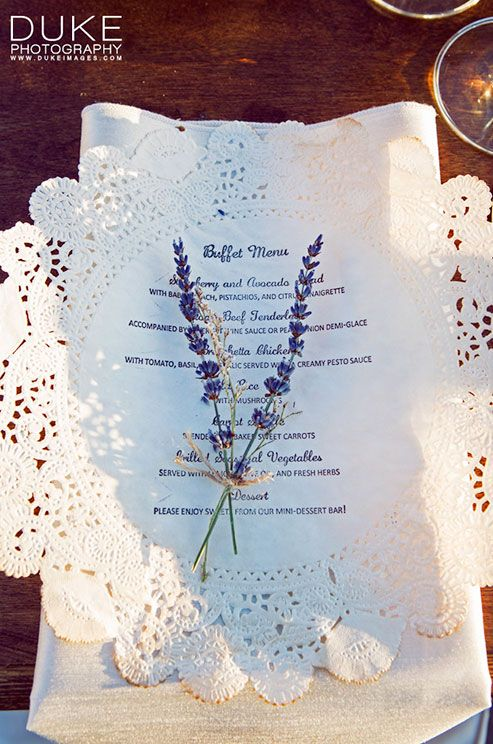 Dinner buffet menus are printed on paper doilies and punctuated with floral sprigs bound with twine.