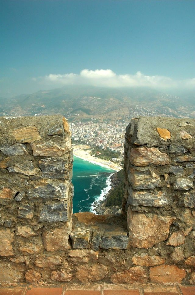 Cleopatra beach through the wall at Alanya Castle  Pinned by TheBarefootNomad.com