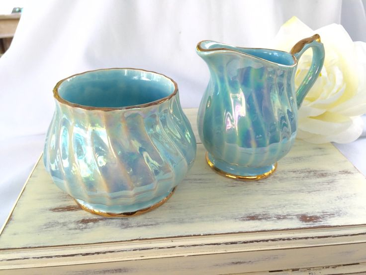 A personal favorite from my Etsy shop https://www.etsy.com/ca/listing/245510010/sadler-gold-swirl-iridescent-blue-cream