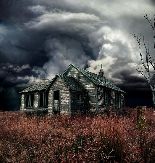 Dark clouds approach an abandoned home that has already seen it's share of storms.
