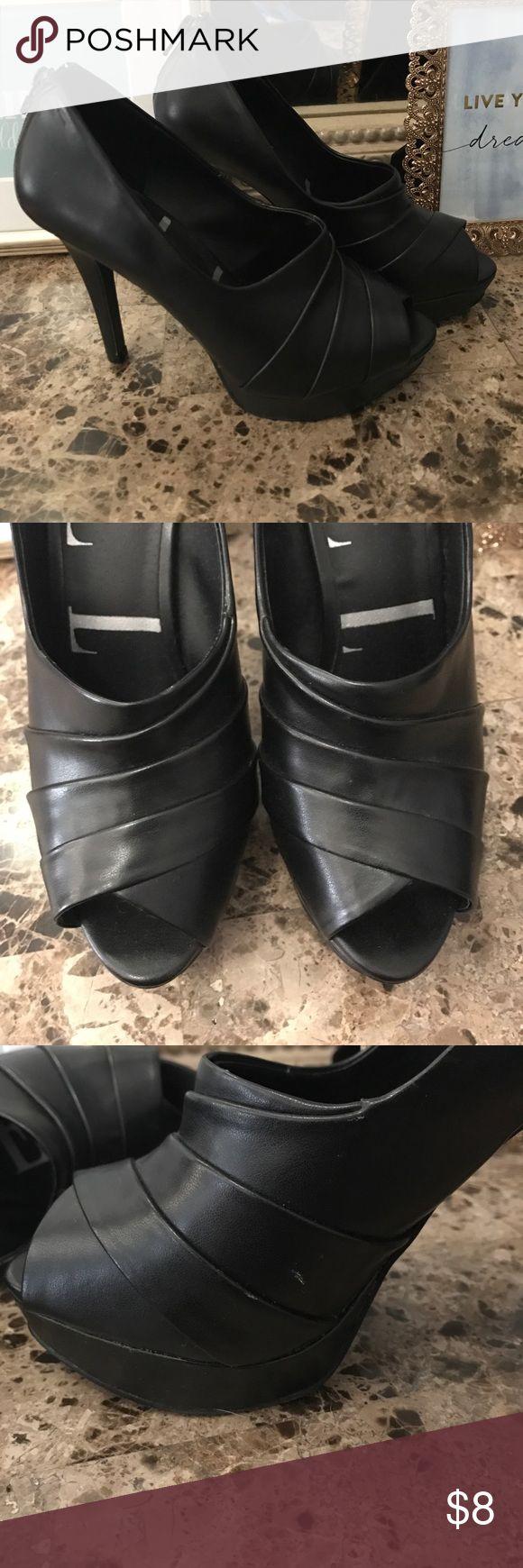 Elle peep toe heels Black peep toe heels. Worn once. Right heel has a white scuff mark as seen in pic Elle Shoes Heels