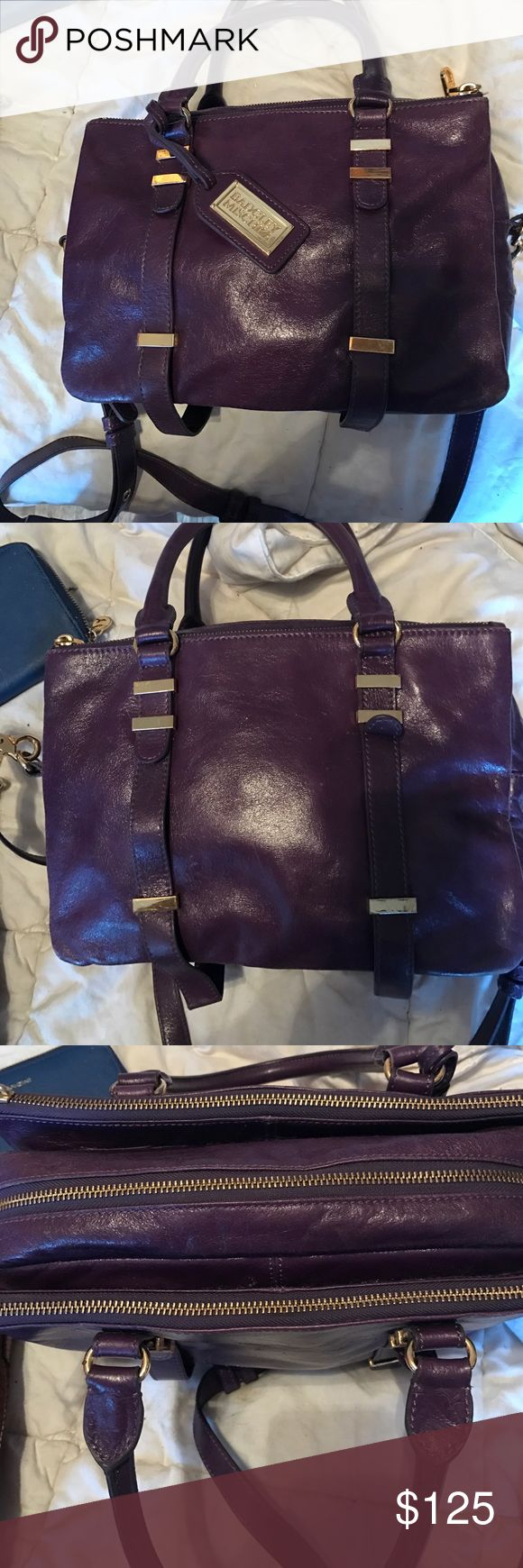Badgley mischka leather satchel in amethyst Got this great satchel a while ago. Love the purple color. I couldn't find the official name of it however. It's a nice square shape,  3 sections all zippered. Has shoulder strap. Very slight claw marks visible in second photo. Badgley Mischka Bags Satchels