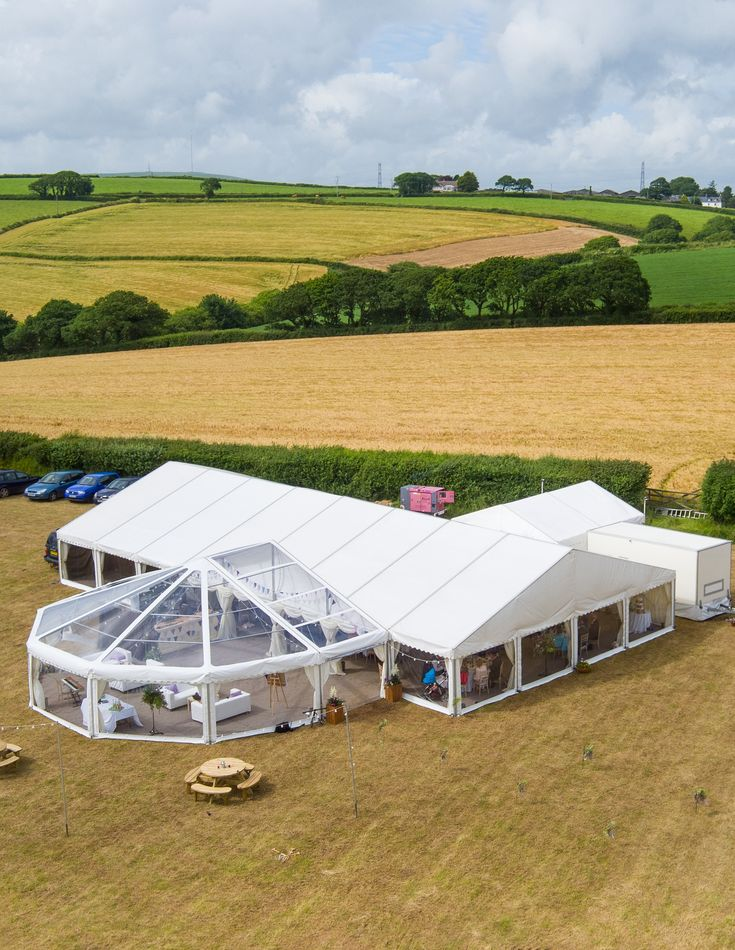 Wedding marquee with clear roof rounded end bar marquee. With catering marquee, furnishings, toilets and a generator to provide power you have a fully functional wedding venue. Looks amazing! Photo Credit: Charlotte Dart Photo and Film