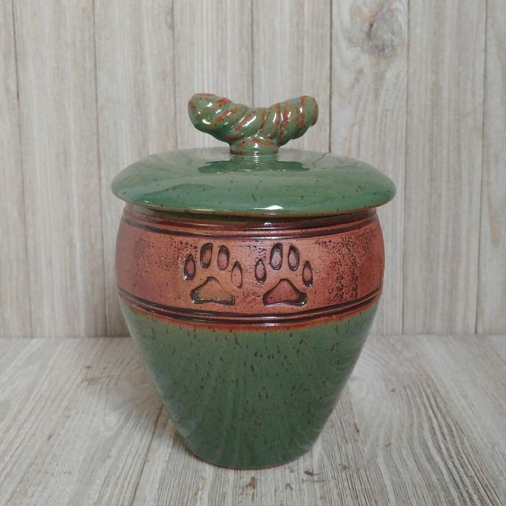 Handmade green paw print ceramic pet urn.  This one of a kind pet urn is suitable for a pet weighing up to 40 lbs.  A beautiful pet urn to celebrate the life of your pet angel.
