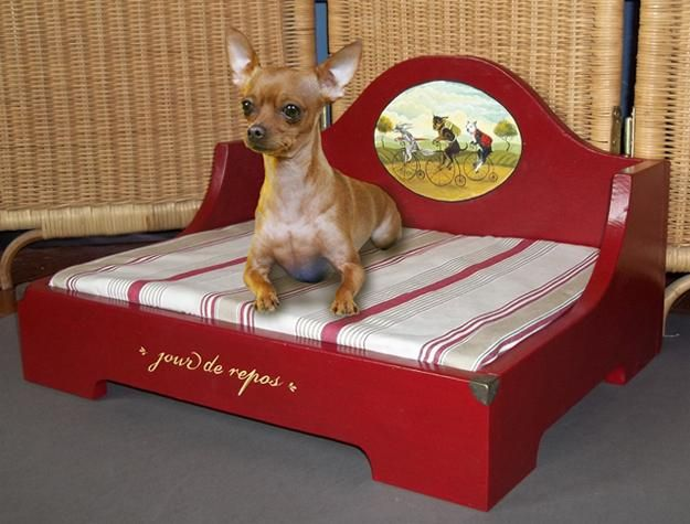 Wooden furniture for pets, dog bed in red color